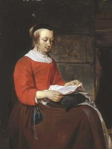 Gabriel Metsu - A young woman seated in an interior, reading a letter