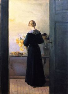 Anna Ancher - Young Woman Arranging Flowers