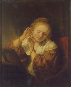 Rembrandt Van Rijn - Young Woman at a Mirror (also known as Young Woman with Earrings)