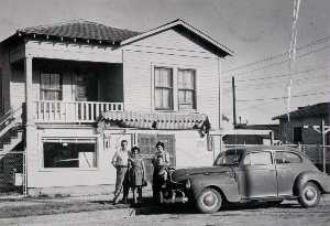 Betty Tichich - R. Carmignani family in front of store at 1502 13th Street, Galveston, 1950, from The Corner Stores of Galveston, Galveston County Cultural Arts Council