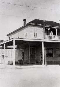 Betty Tichich - Stiglich Grocery, Mrs. Stiglich's father in law and mother in law on upper porch, 1932, from The Corner Stores of Galveston, Galveston County Cultural Arts Council