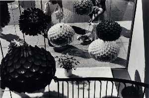 Burk Uzzle - Untitled (Paper Lamps, Window View of Woman Walking Dog)