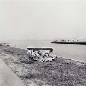 Burk Uzzle - Untitled (2 People and Dog, Sunning near Waterway)