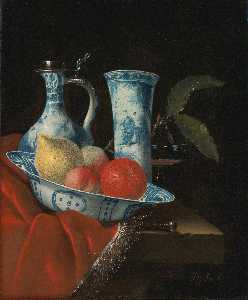 Juriaan Van Streek - Still life of a blue and white Wan li bowl with peaches, a lemon and an orange, a porcelain ewer and vase, a wine glass and a knife, on a partly draped stone ledge