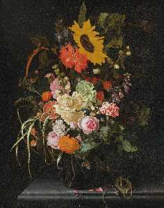 Maria Van Oosterwijk - Still Life of Roses, Carnations, Marigolds and Other Flowers with a Sunflower and Striped Grass, in a Glass Vase with a Knife and String upon a Marble Ledge